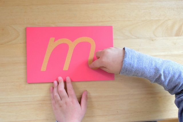 Tactile letters made of sandpaper can help students trace the letters as they say the sounds. (Photo by  Lisa Maruna .)
