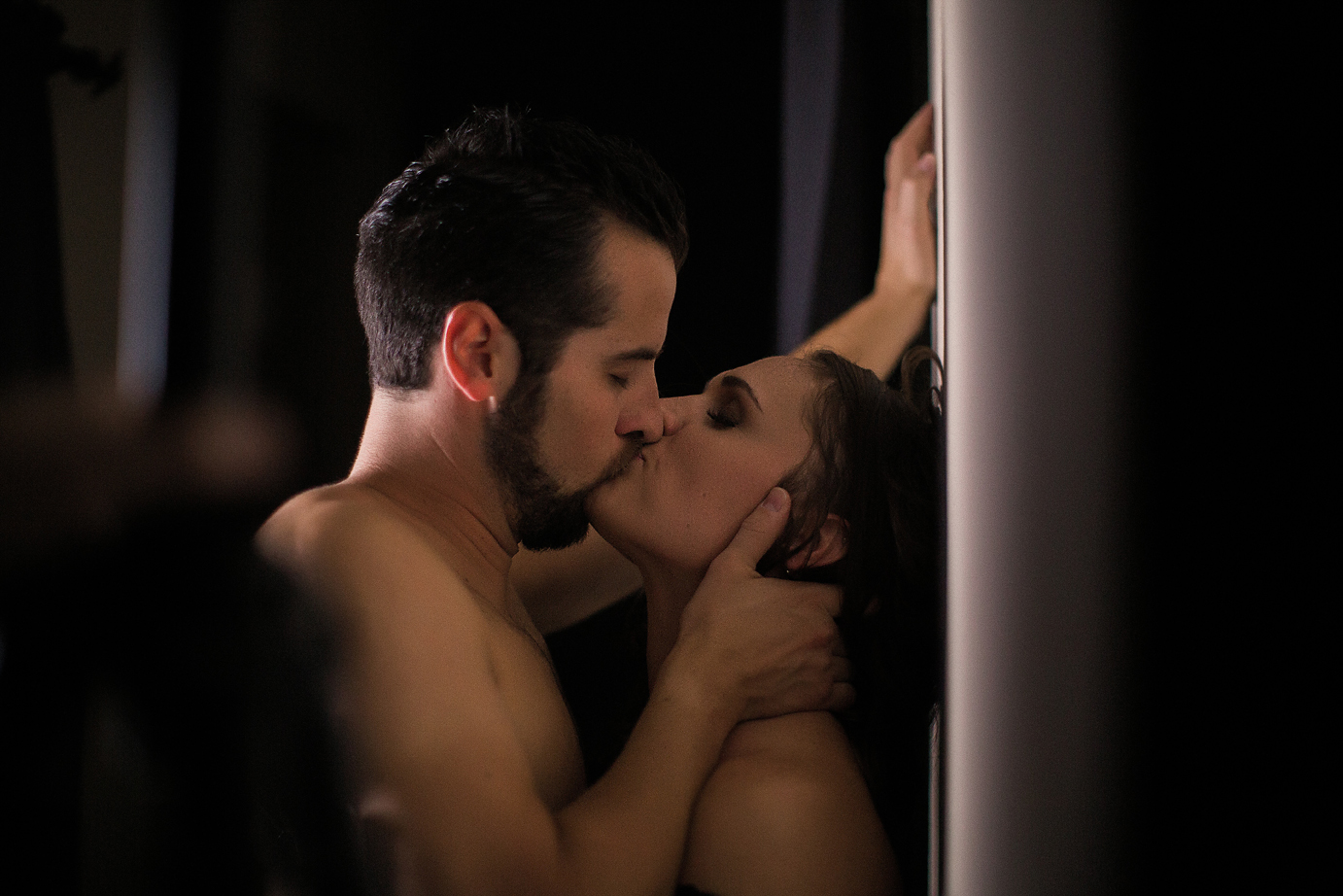 oc-couples-boudoir-studio-husband-and-wife-sexy-photoshoot-passionate-kissing-hallway.jpg