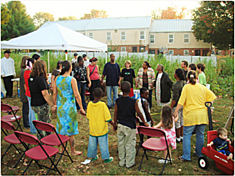 Neighbors join together for the pumpkin harvest and Swiss chard recipe sampling at 6th Street – October 2007.