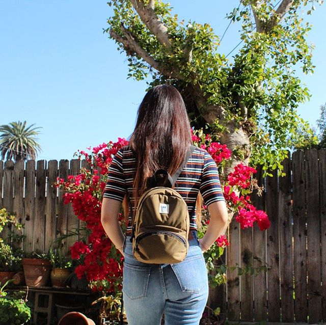 Our Trotter Mini Backpack in Coyote Brown.  Roomy main compartment w/ interior mesh pocket, exterior bellow zipper pocket, adjustable straps & top handle.  We have a few left, also available in our Spring/Summer2019 prints.  Limited supply.  Handcrafted in USA.