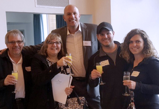 Don and Charlene Singbeil, Jeff Singbeil and Olivia Hill celebrating the purchasing of their lots at The Foothills with Marketing and Sales Director, Ben Hurlbutt.