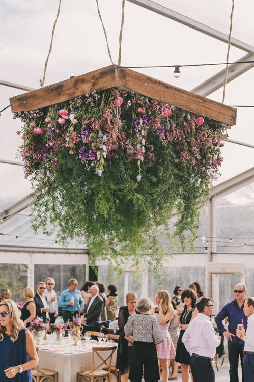 Hanging botanical structure by  Mondo Floral Designs .
