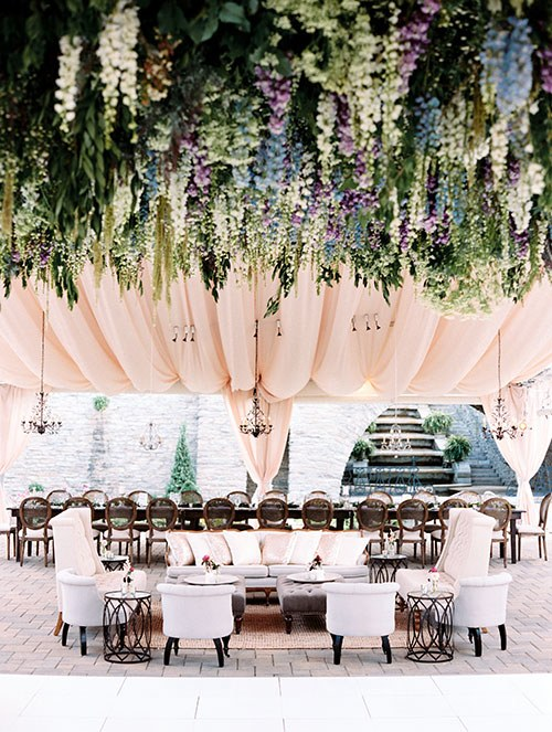 Floral canopy by:  Yellow Canary . See more from this wedding on  Brides.com .