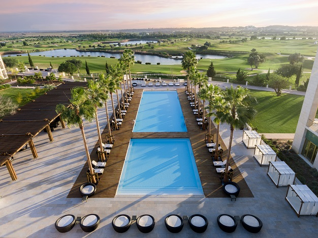 Anantara Vilamoura - main pool with golf course backdrop - low res.jpg