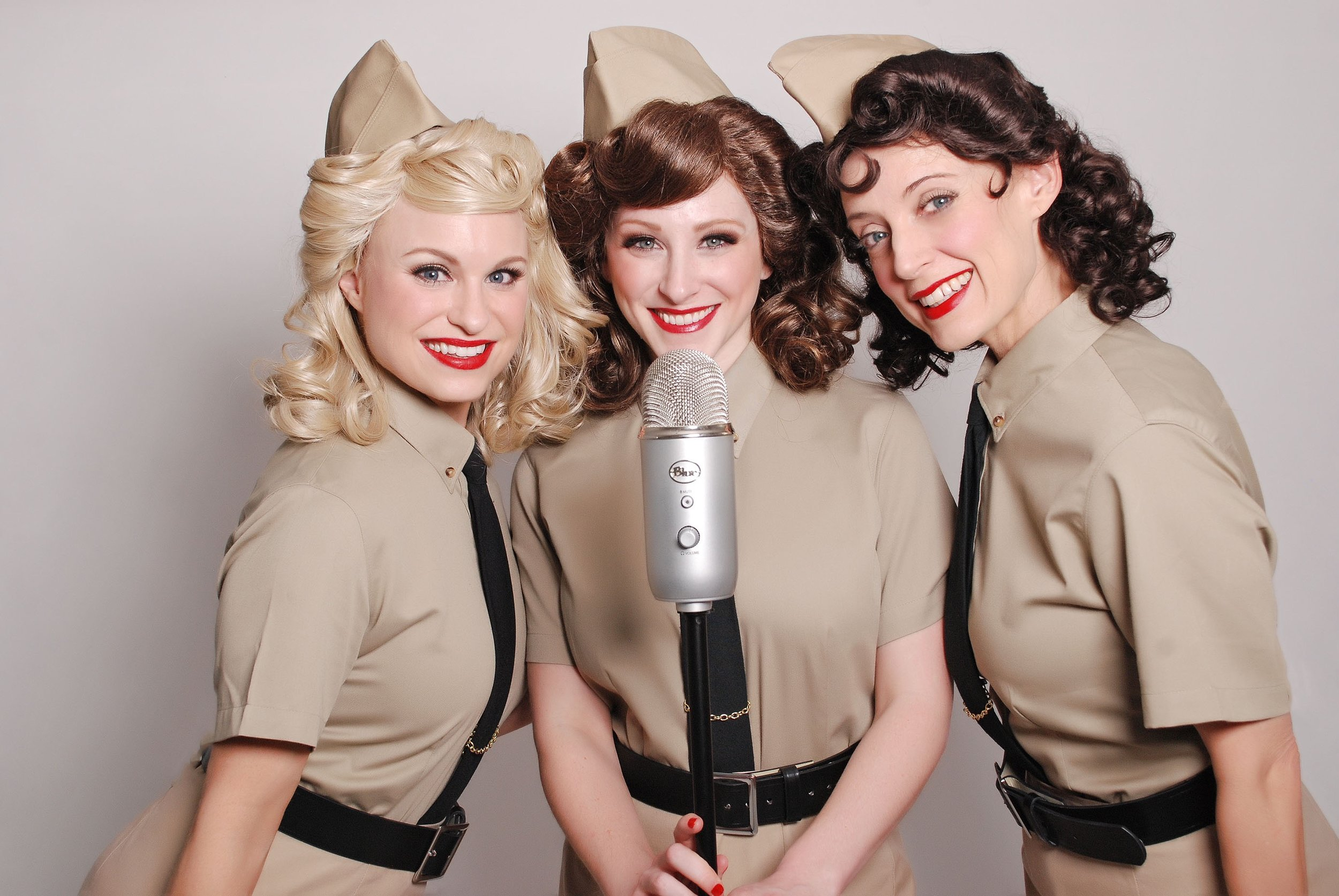 The Swing Dolls as The Andrews Sister Blue microphone