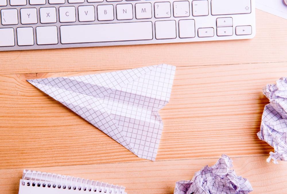 paper airplane in office.jpg