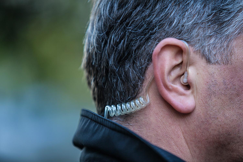 man wearing earpiece