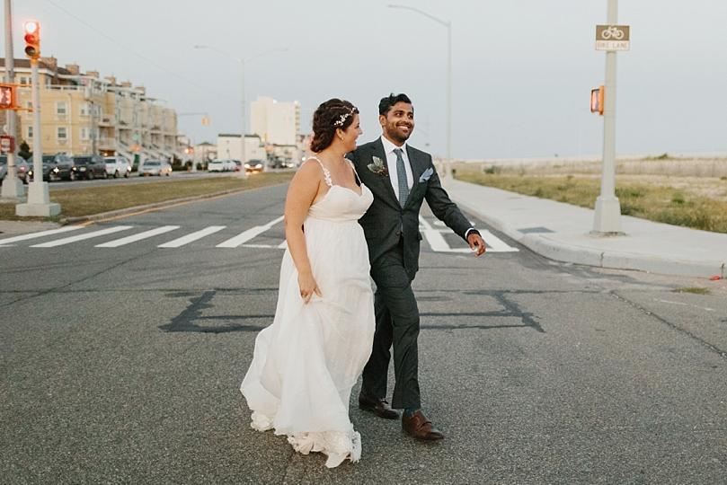 Bride and Groom Walking Across Street in Rockaway New York