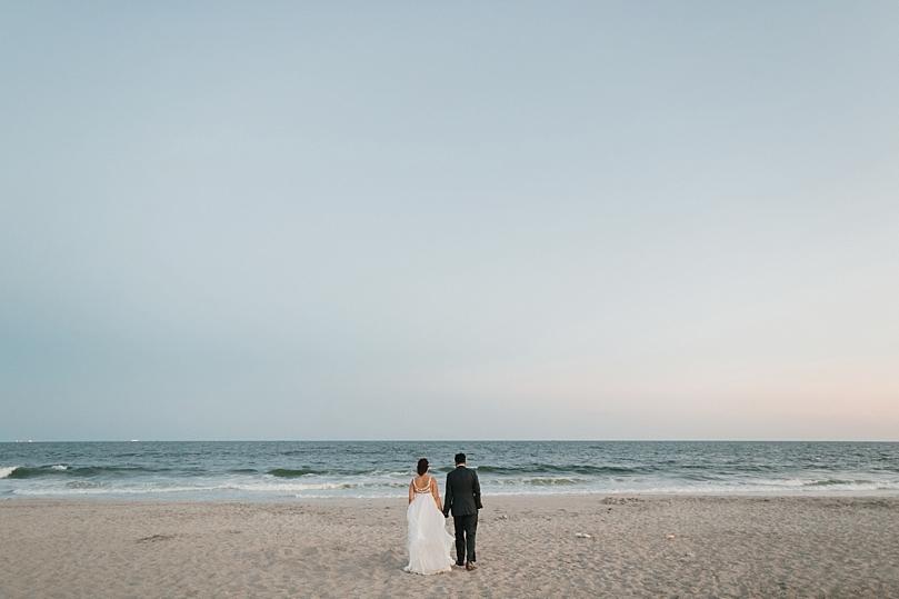 Married Couple Walks Towards Ocean in Rockaway New York
