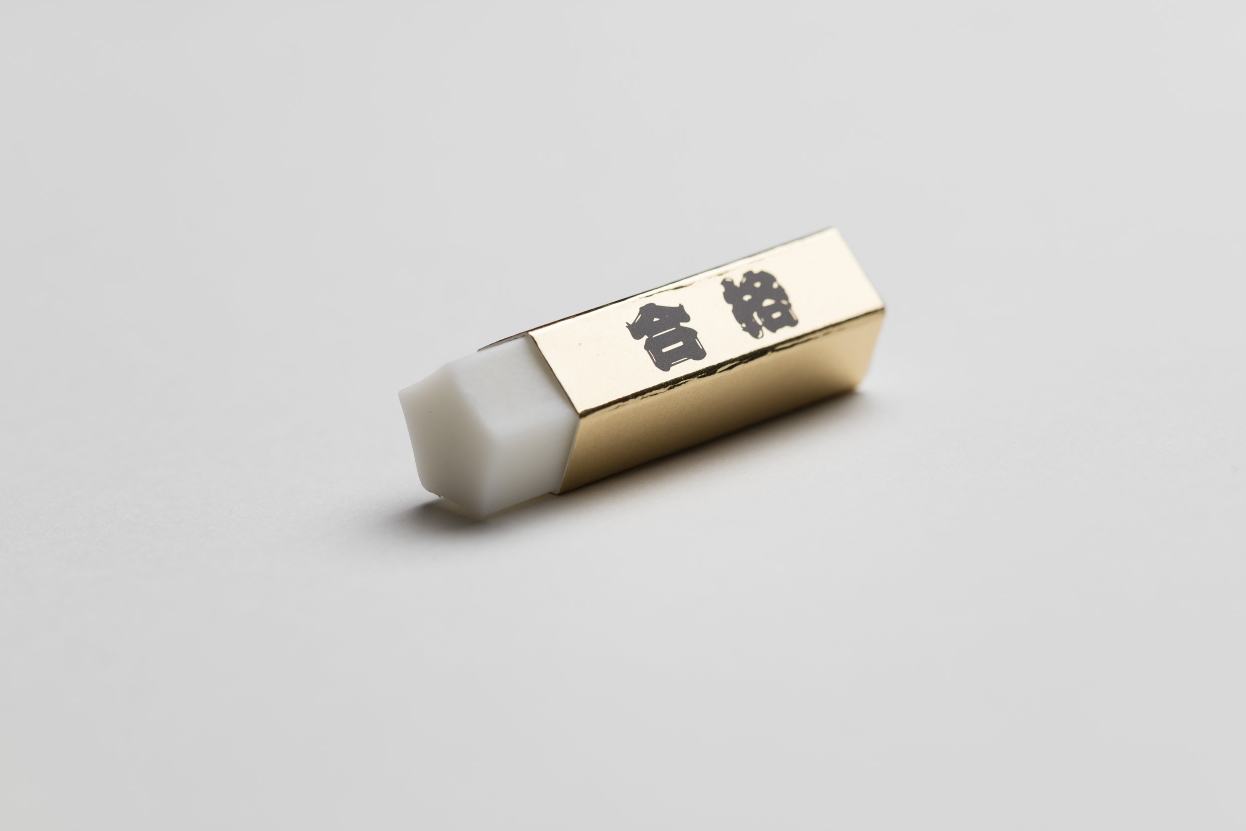 Lux-looking gold-wrapped eraser