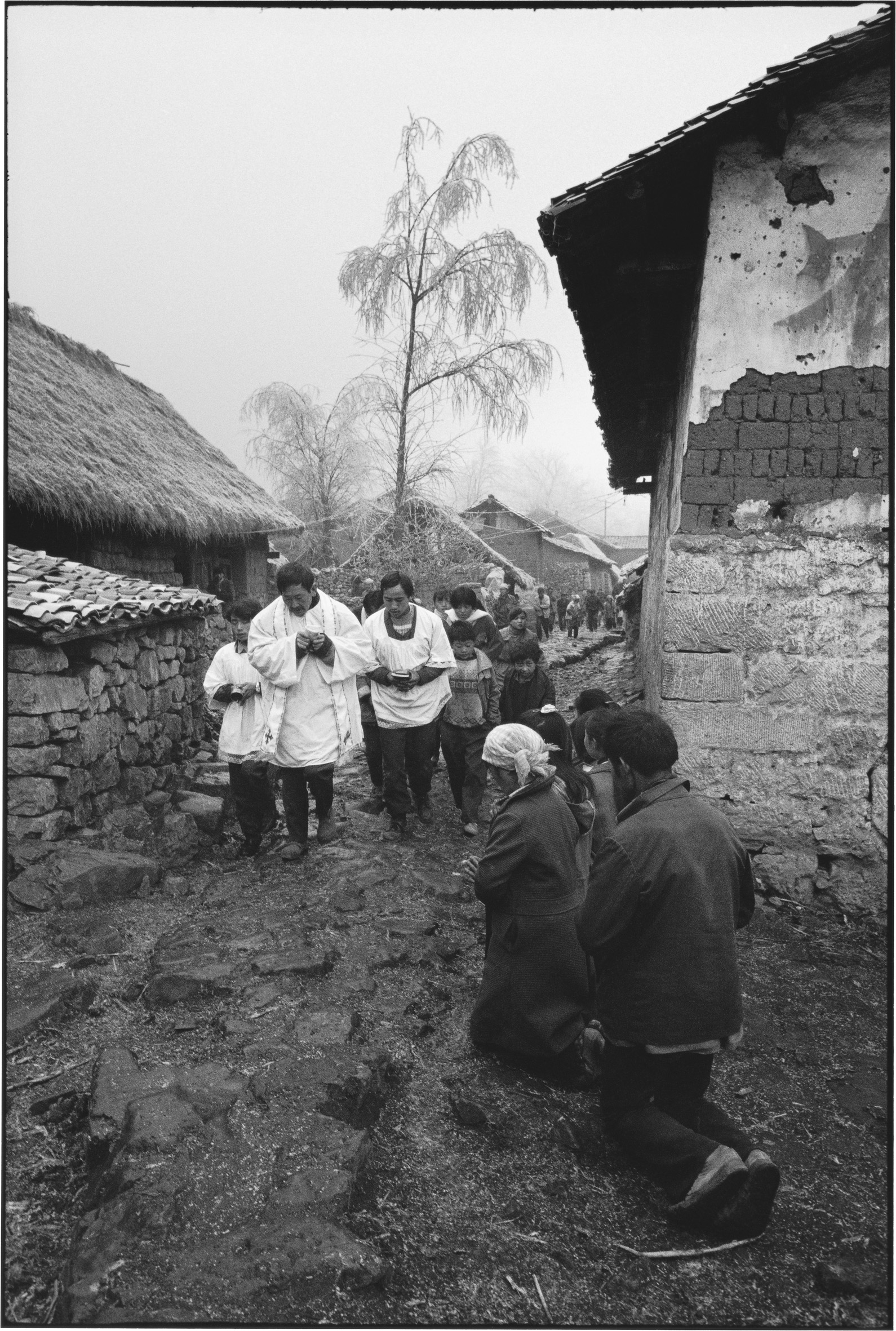 A Priest Carrying the Host with His Congregation, Yunnan, China