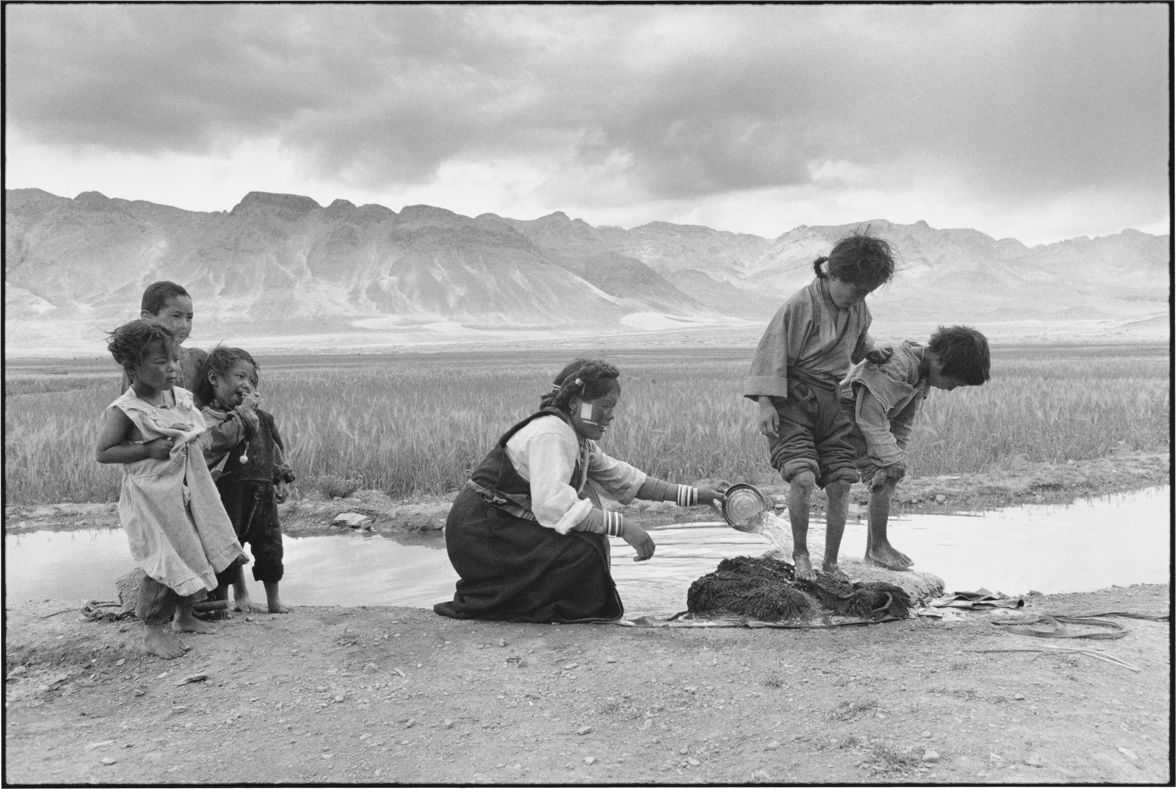 A Woman and Her Children Washing Bedding, Tibet