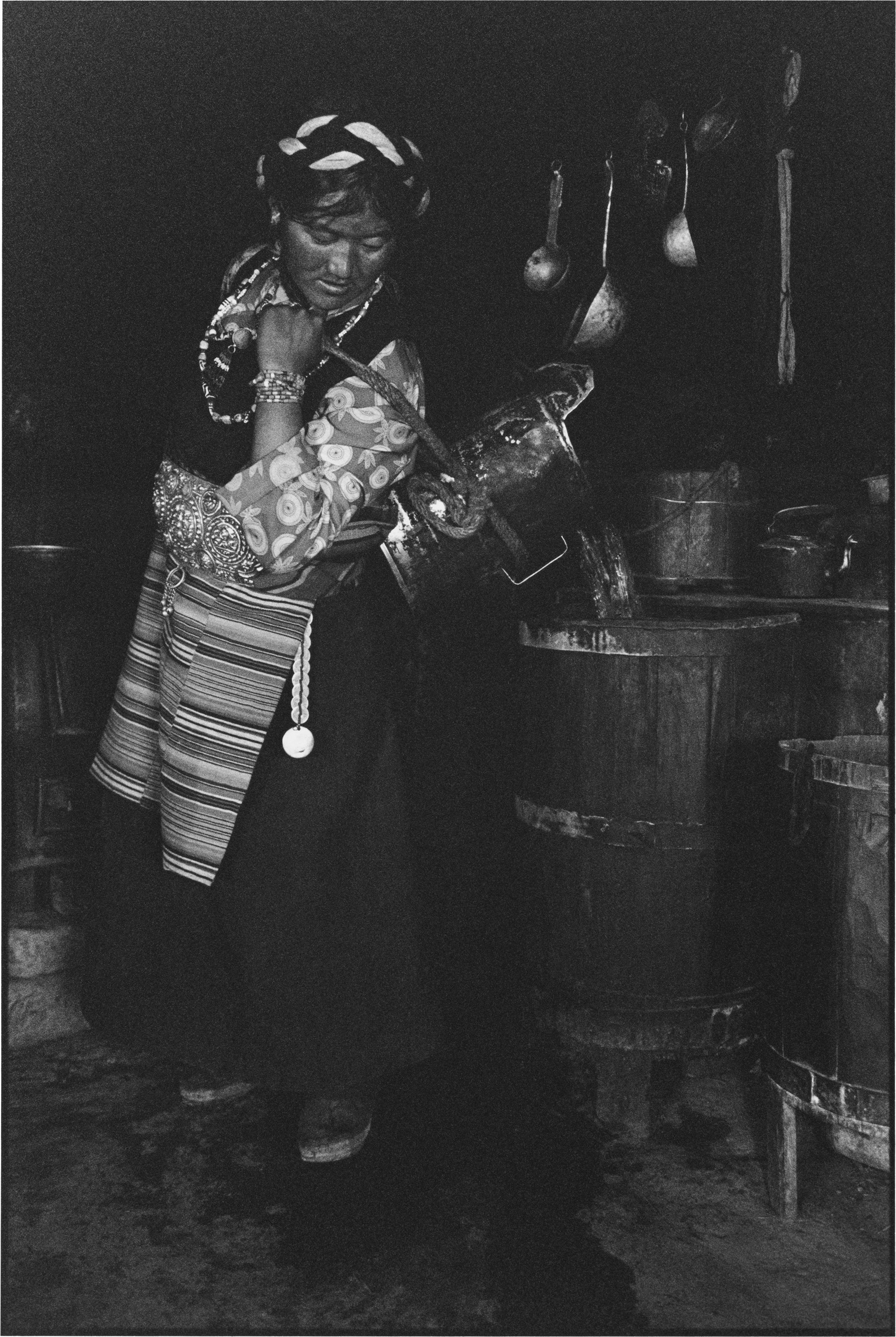 A Woman Pouring Water, Tibet