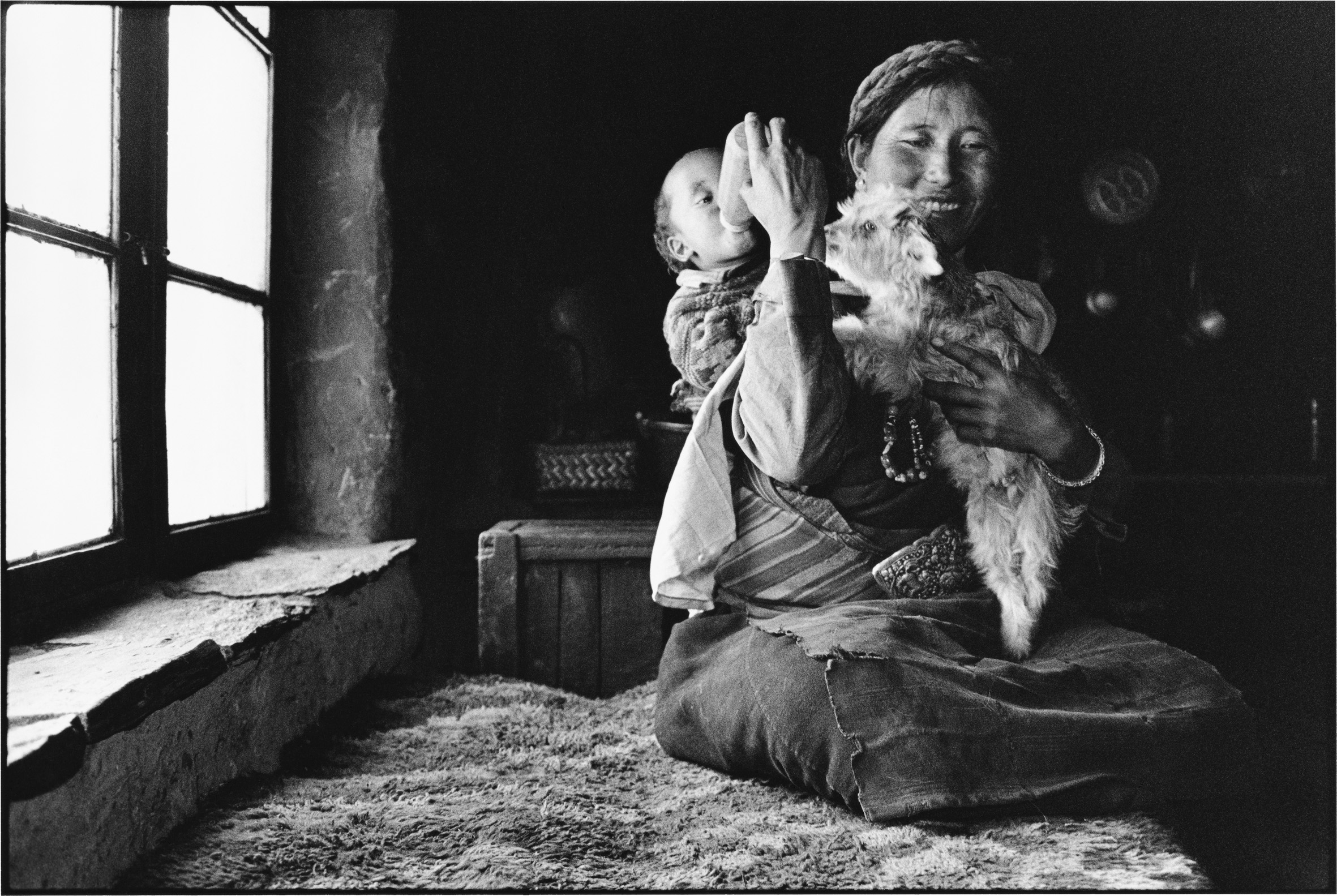 A Woman Feeds Her Baby and a Lamb, Tibet