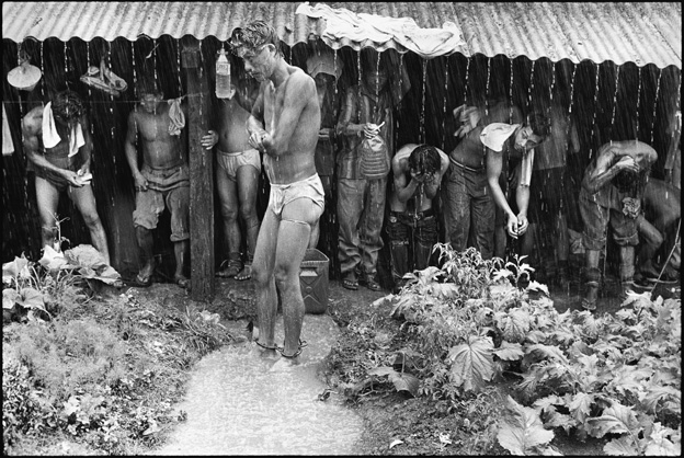 Prisoners Bathing in the Rain and Collecting Rain Water