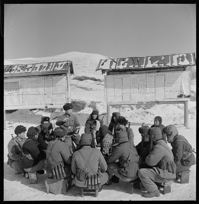 Despite the cold, PLA soldiers continue to study revolutionary theory.