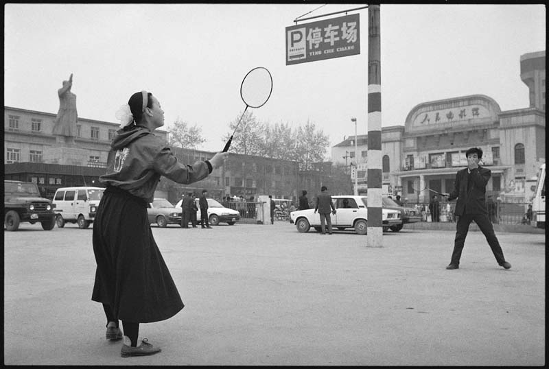 Young Men Playing Badminton
