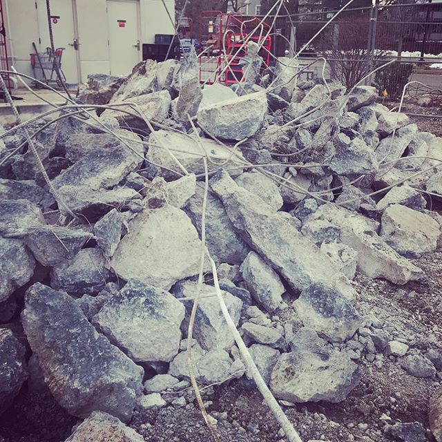 Old concrete pad demolition leaving behind a mess of rebar and rubble.
