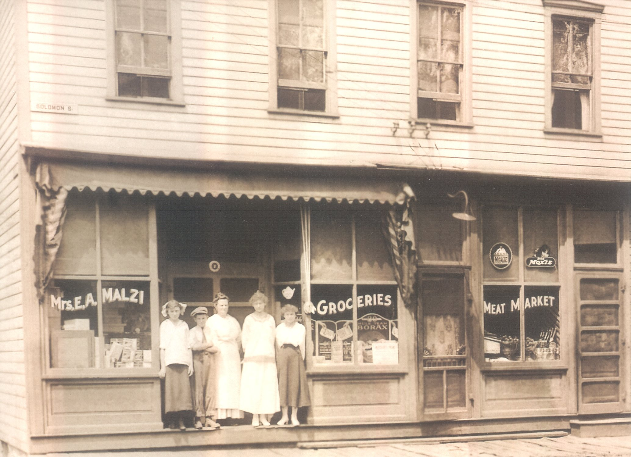 Mrs. E. A. Malzi - Groceries and Meat Market