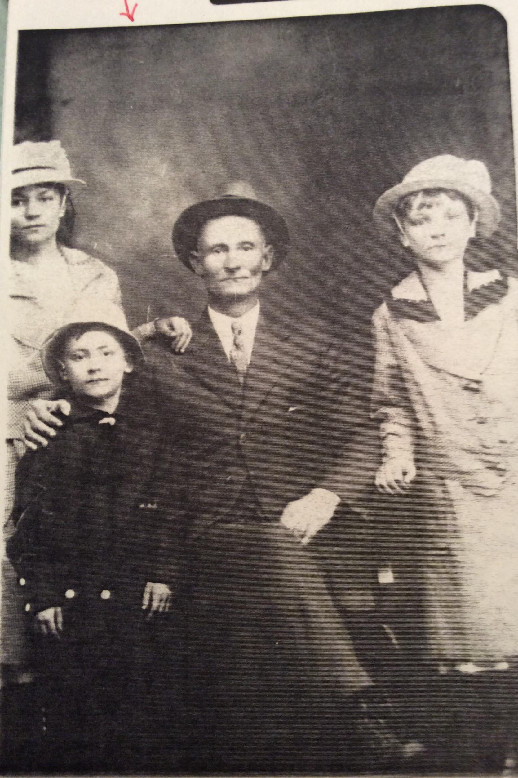 Thelma (right) with her siblings, Mildred and Robert, and her father, James. (abt. 1916)