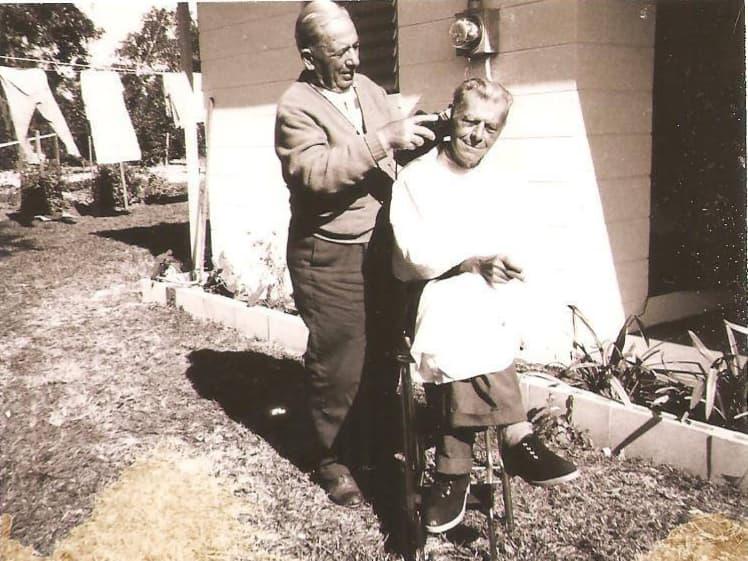 Bill Karr cutting hair in the yard