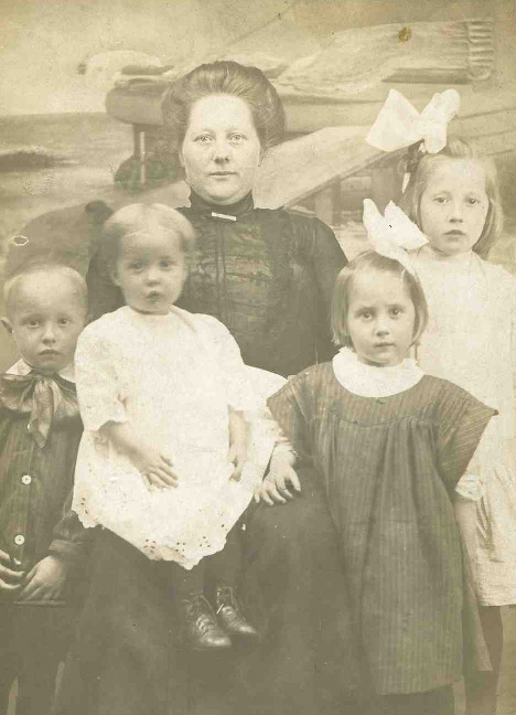 Margaret with four of her children (left to right): Germain, Hyacinth on lap, Lucile (twin of Germain), and Ruth