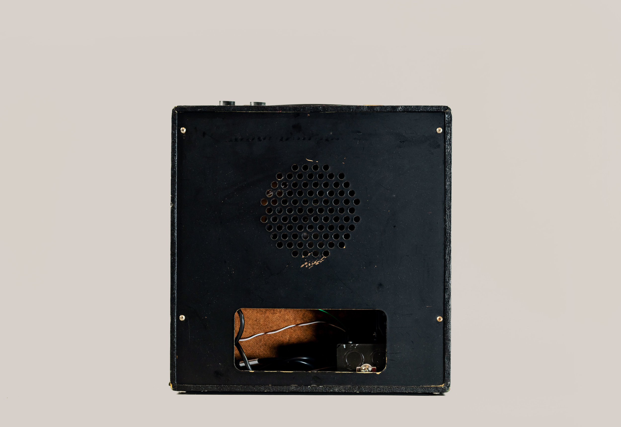 The switch was originally on the volume knob. We moved it to the back, on the power supply chassis.