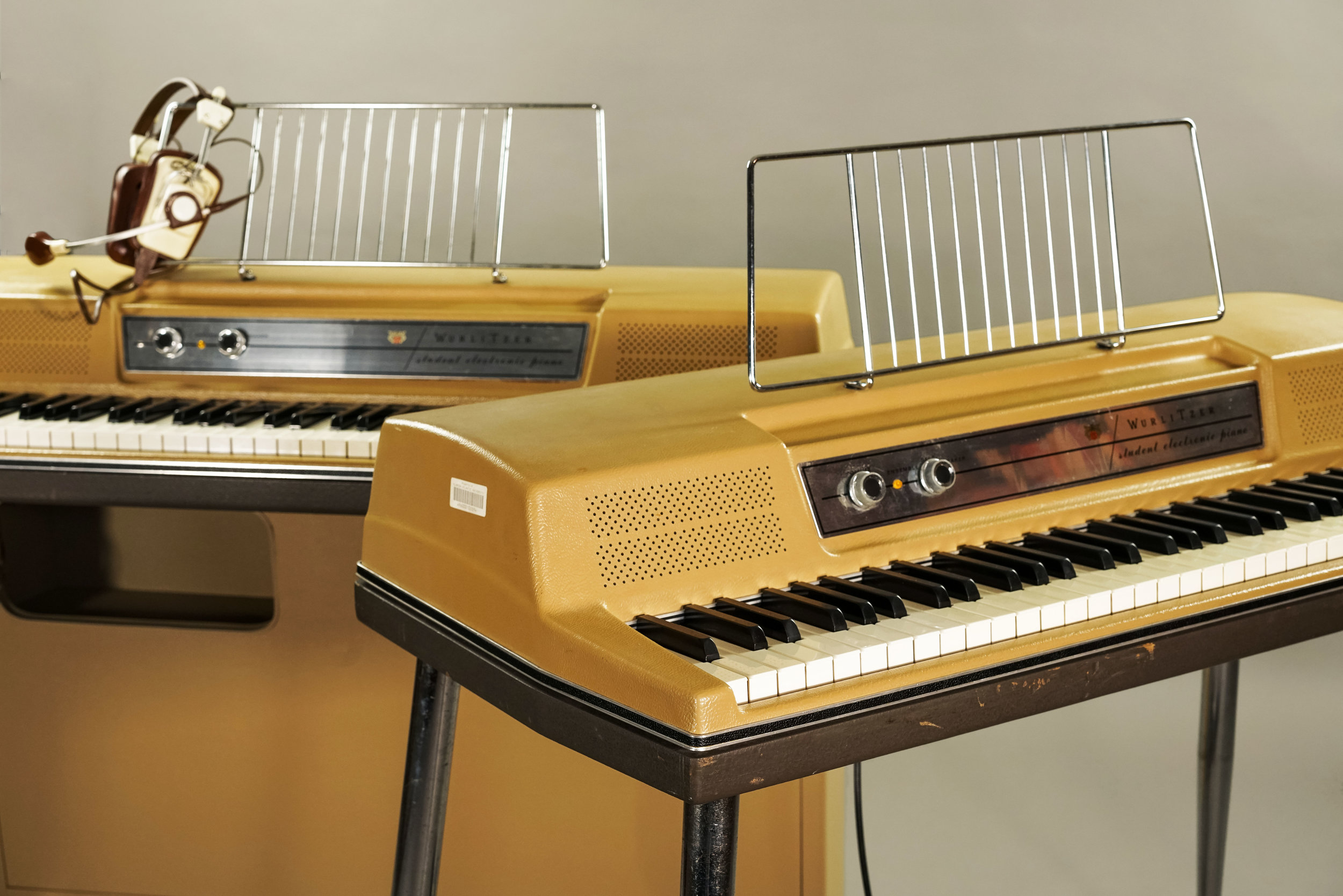 A vintage Wurlitzer 206, and a version of the same keyboard on legs.
