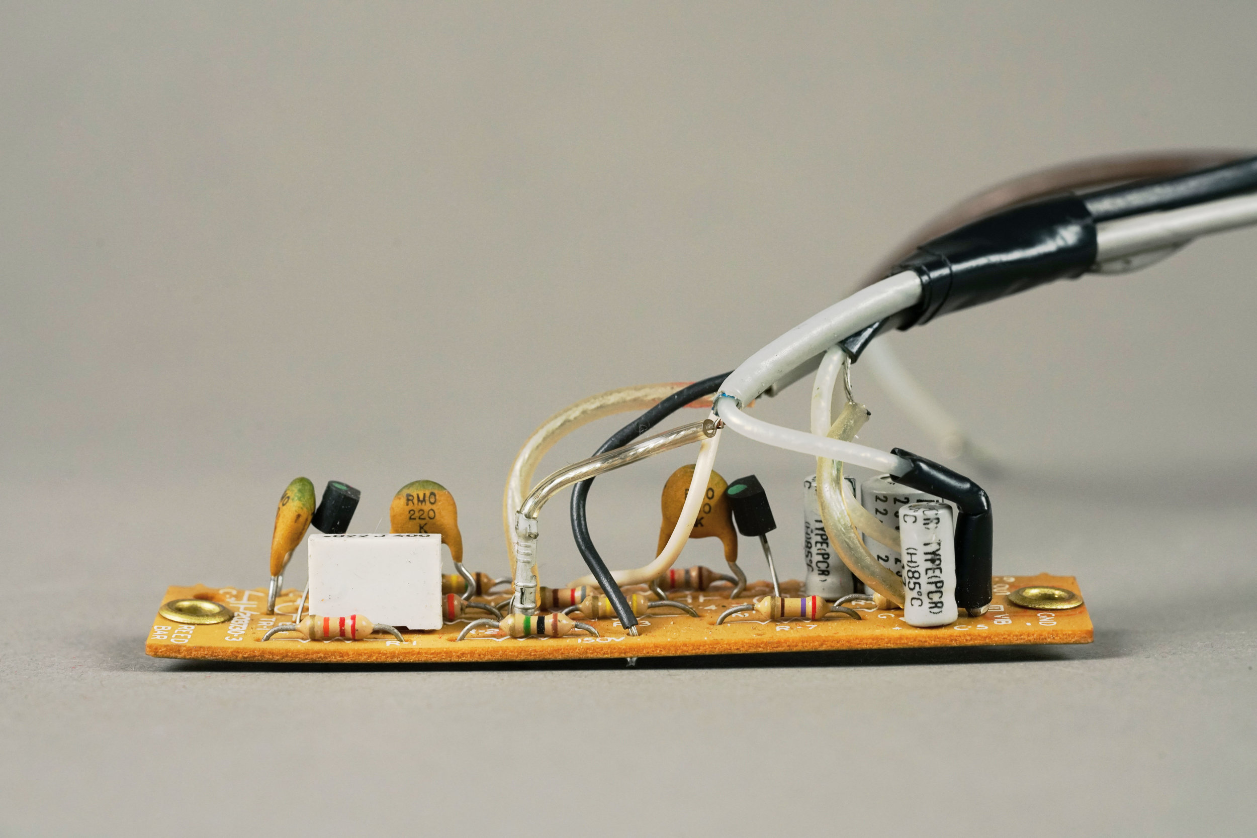 The input components in the  Wurlitzer 200a  amplifier are on a separate circuit board that is mounted above the reed bar. Note that, unlike previous models of resistors, the 200a has carbon film resistors. These are less noisy than carbon composition resistors, but not as low-noise as metal film.