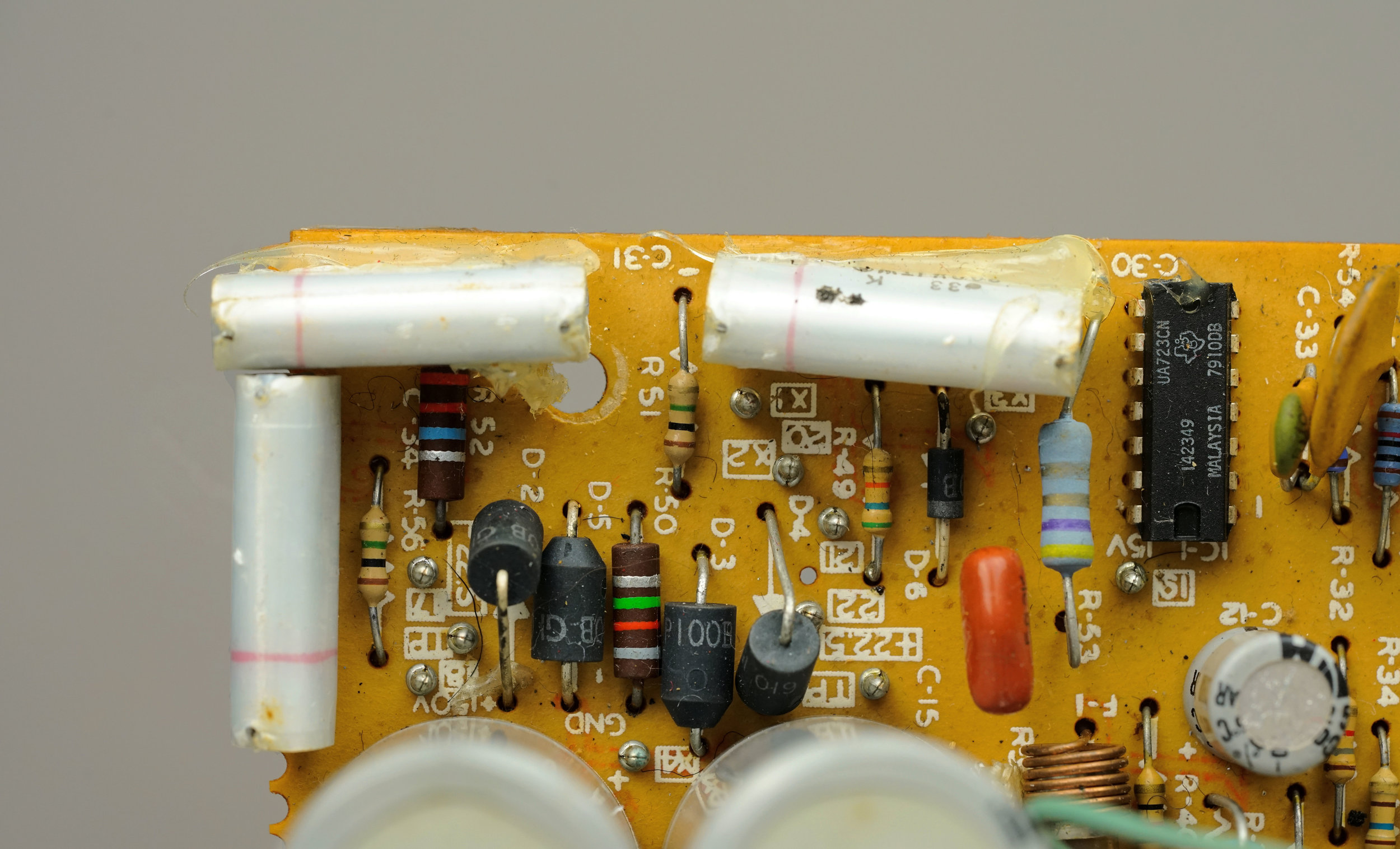 Carbon composition and carbon film resistors coexisting in a  Wurlitzer 200a  amplifier. This is the power supply section. It's possible that carbon composition resistors were used here because they tolerate high transient currents better than other styles.