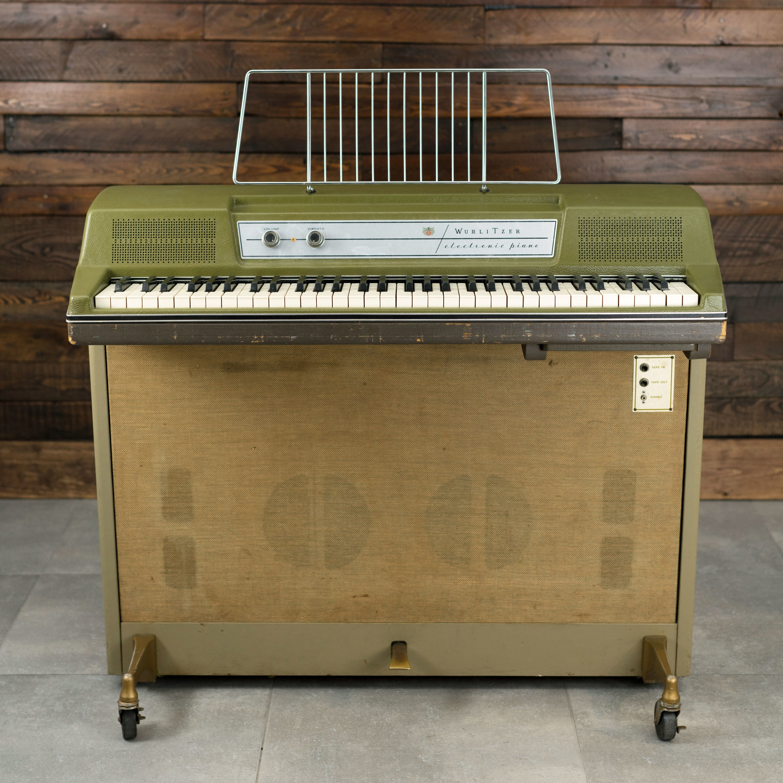 Wurlitzer 214 in Avocado green with gold hardware and wheels.