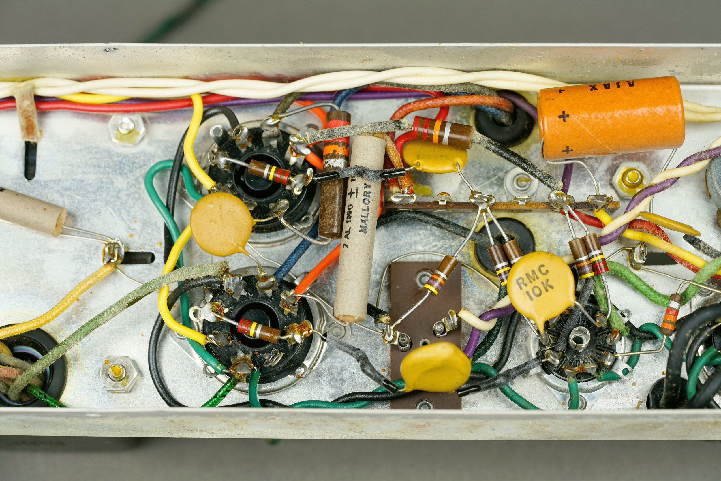 At some point, somebody else had re-wired the heaters in this Wurlitzer 112 amplifier. (They're the twisted green and black wires.) It's not perfect because there are still large loops around the tube sockets. This wiring could be improved if the twist were to continue all the way up to the sockets.