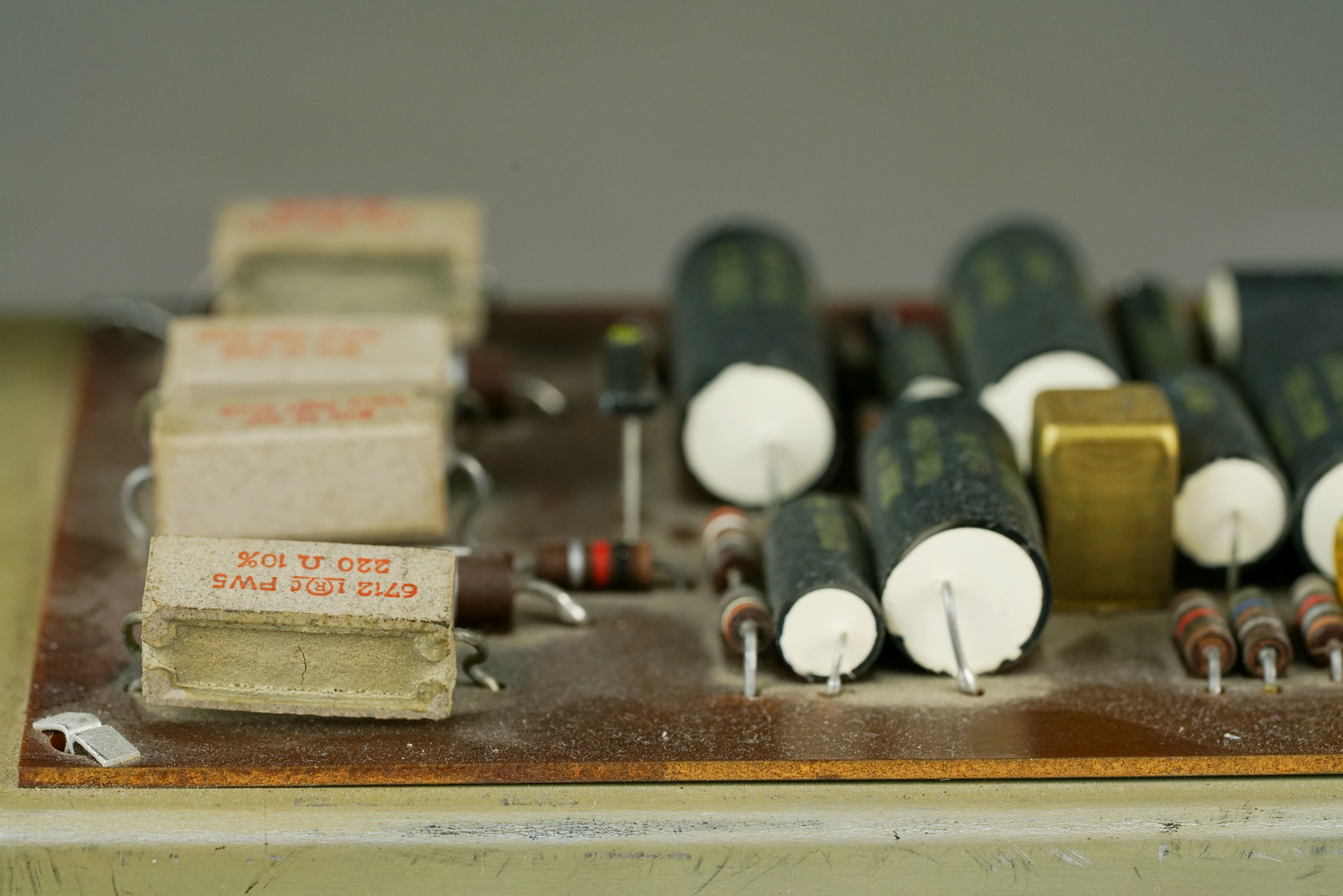 These high-wattage resistors, found in a Wurlitzer 140b amplifier, are part of the power transistor biasing circuit.