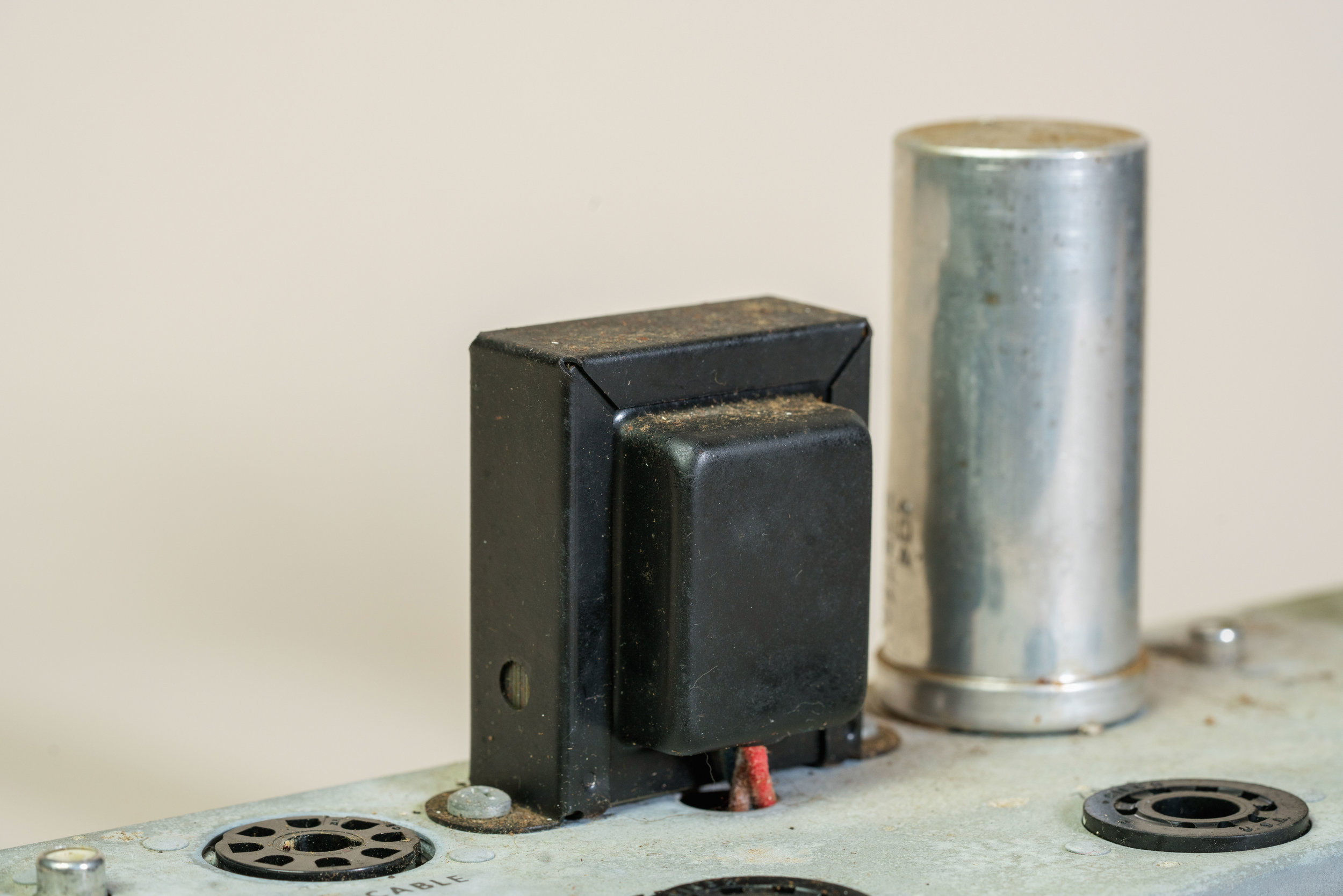 The capacitor can in a Wurlitzer 145 amplifier.