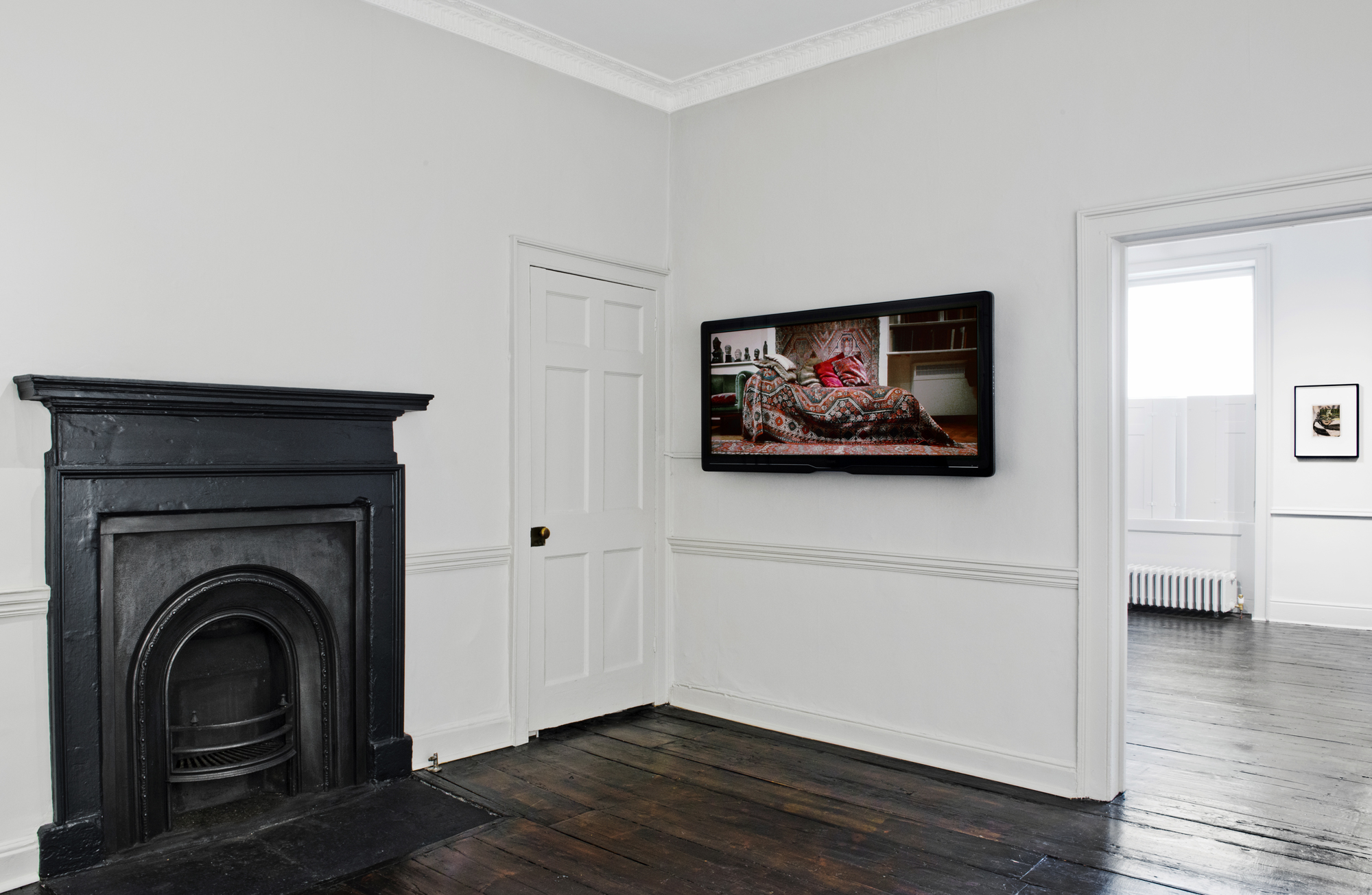 Installation view -Amie Siegel in foreground, John Stezaker in far room