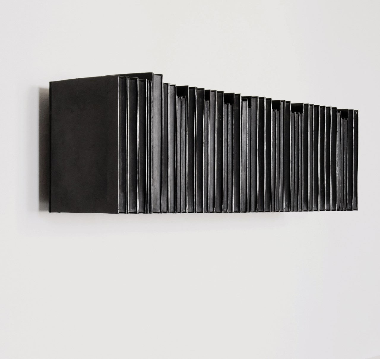 Rachel Whiteread,   Untitled (Black Books) , 1997, Black pigmented plastic and steel, 30 x 101 x 23 cm, edition of 10