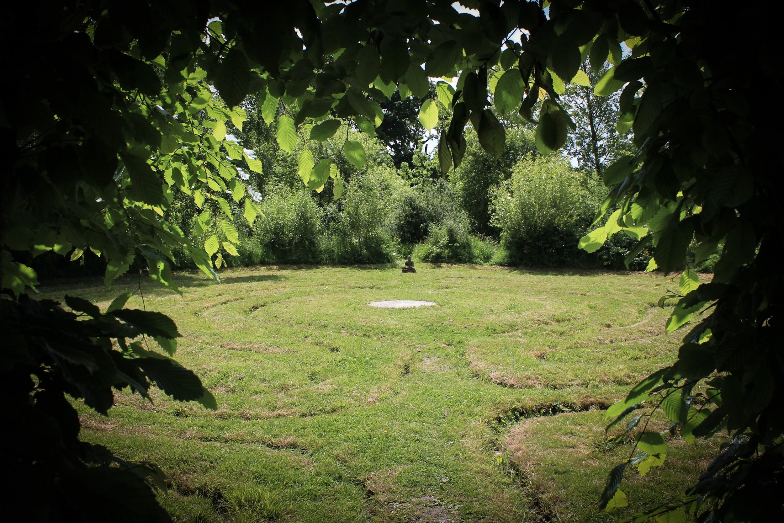 The Mizmaze, and Buddha, children follow the path to the centre, the path is worn deep by thousands of little feet.