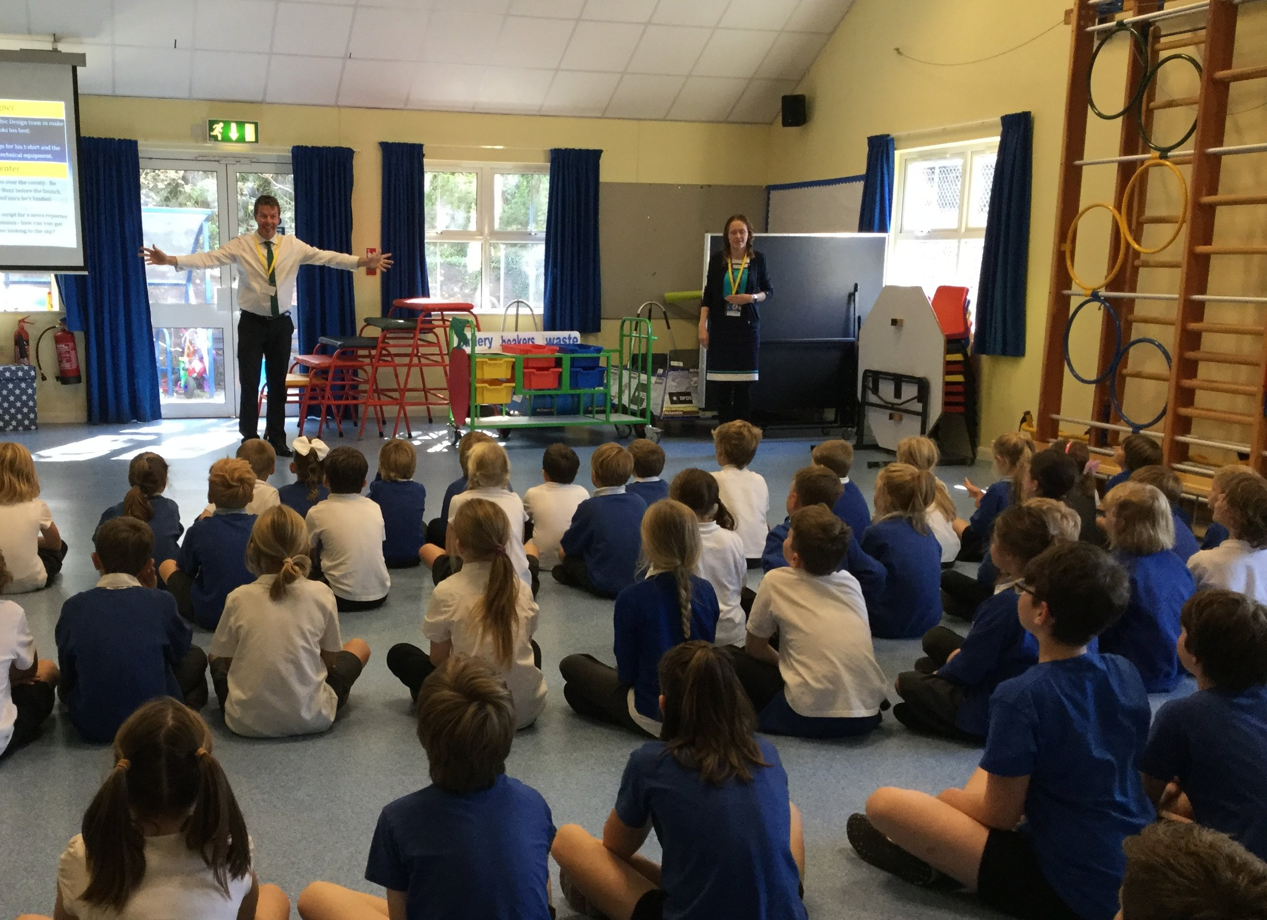 Pupils at Portreath Community Primary School listening to Phil, Head Geek, about Buzz
