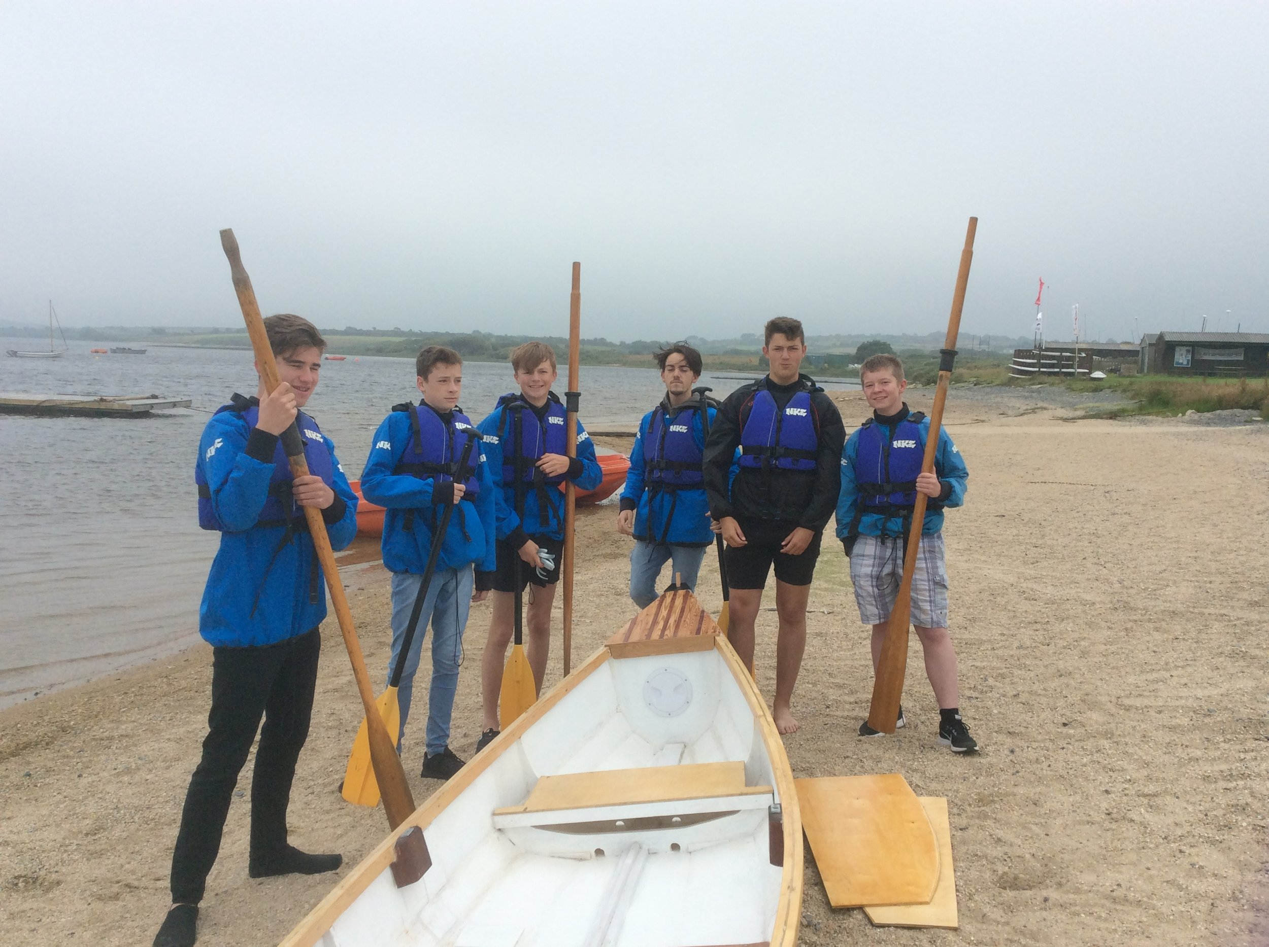 Students ready to row the boat they made at Pool Academy.  Charlie, Dan, Evan Connor,  Connor and Rhys.