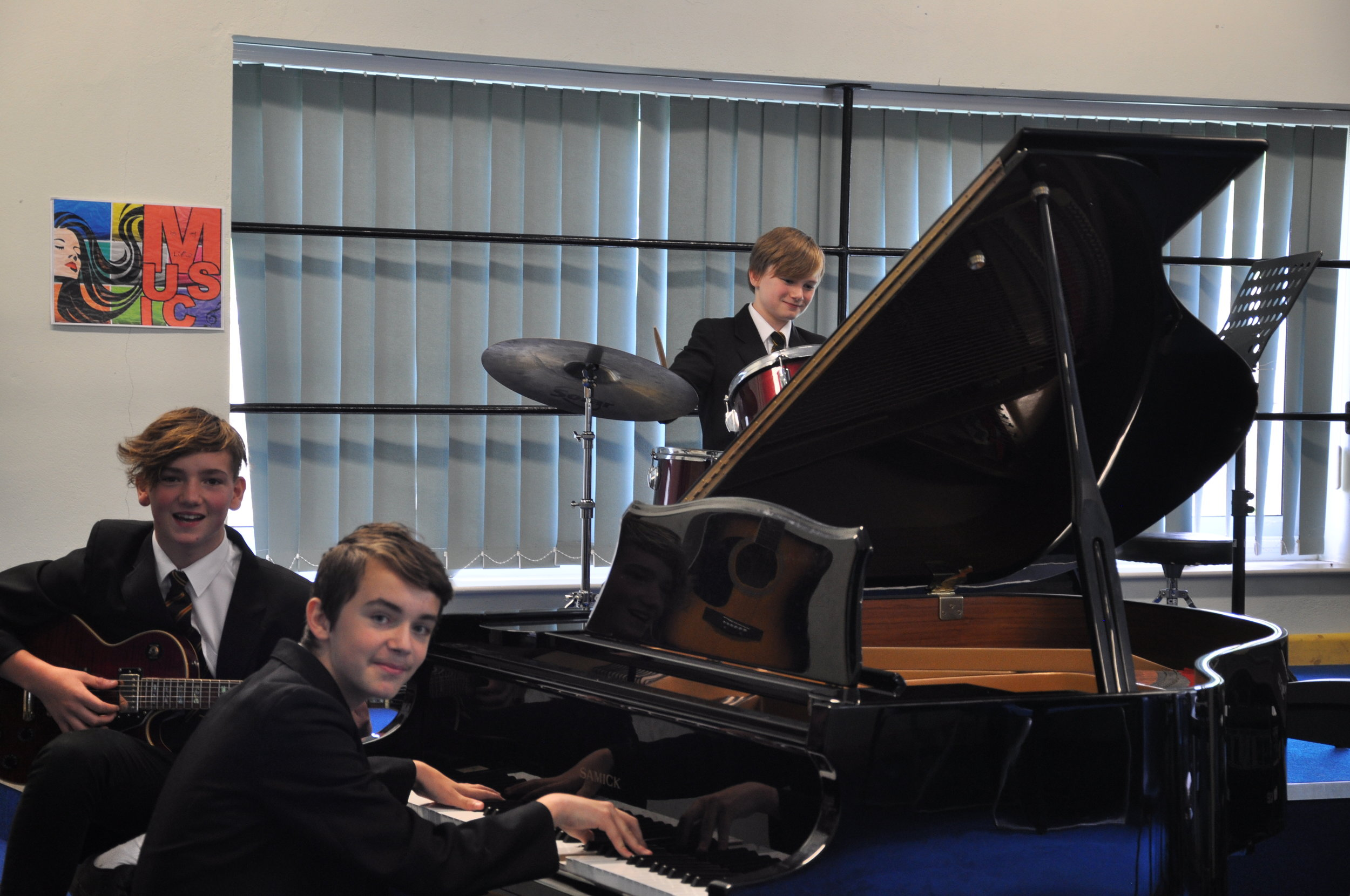 Pool Academy students rehearsing for School of Rock musical