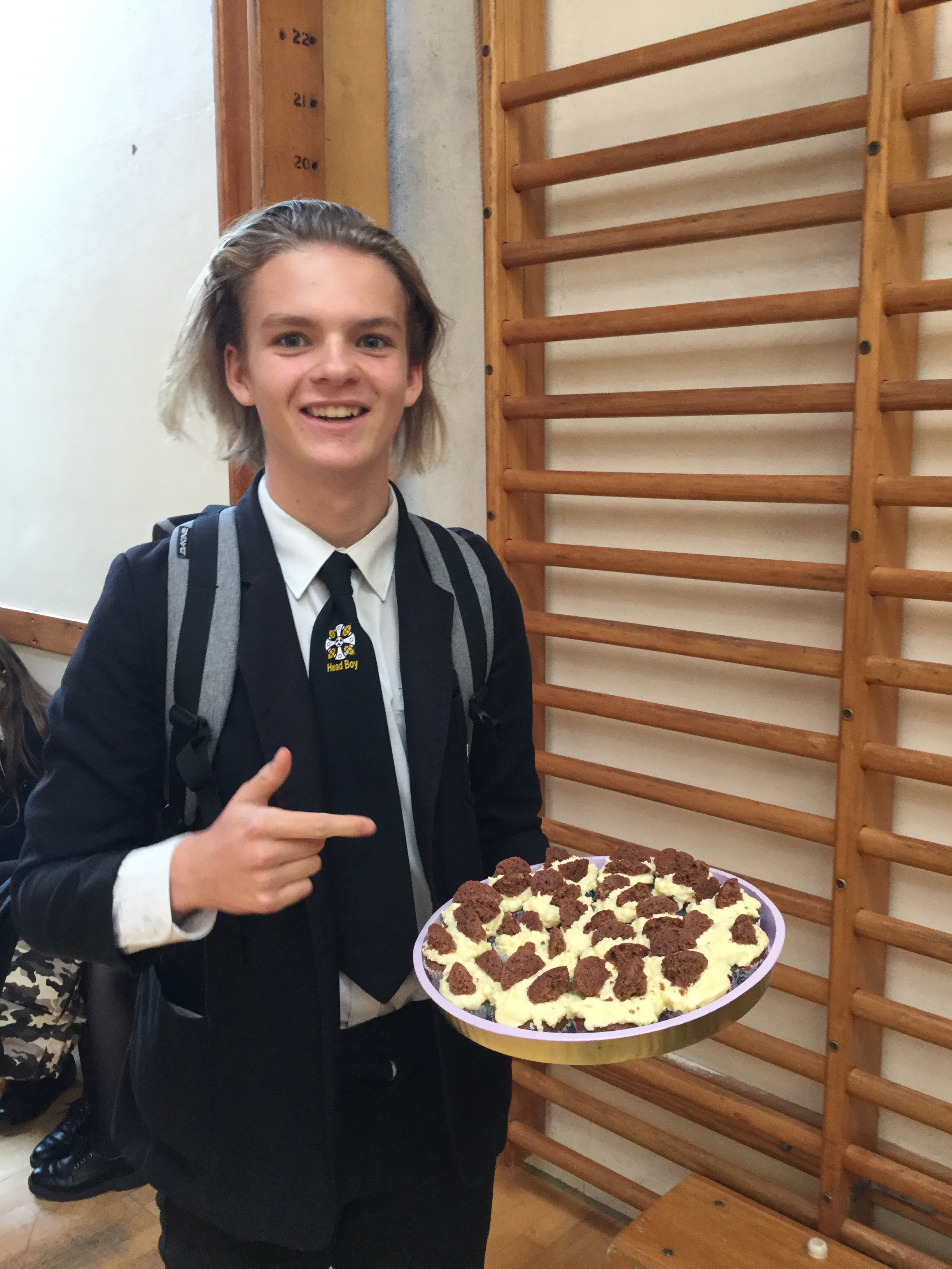 Sol, Head Boy, with his selection of cakes for sale.