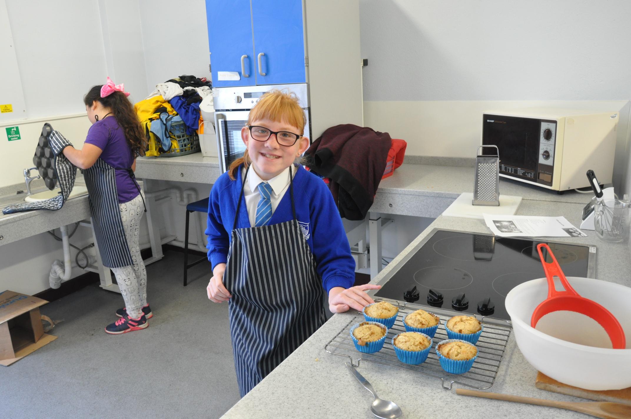Ella with her muffins