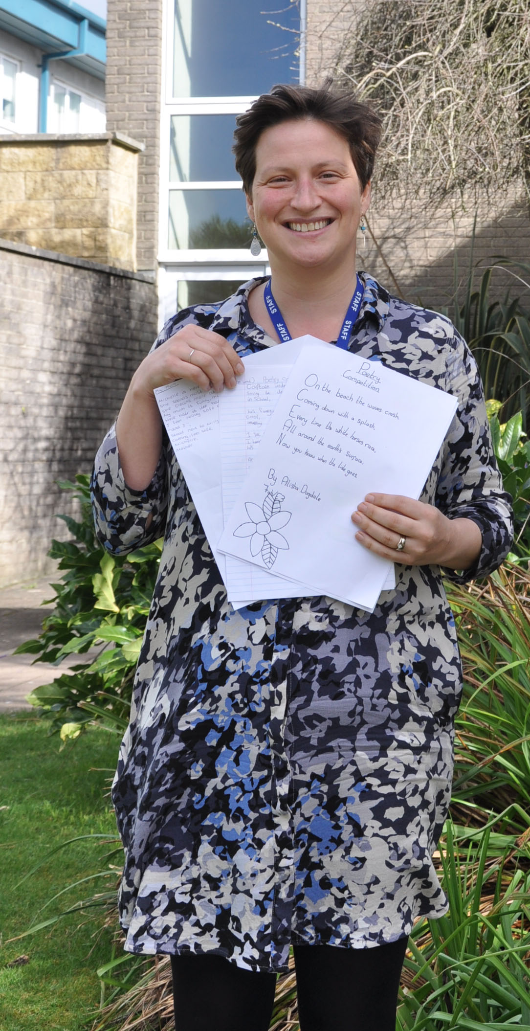Abi Ludlow, English teacher, with some of the poetry entries.