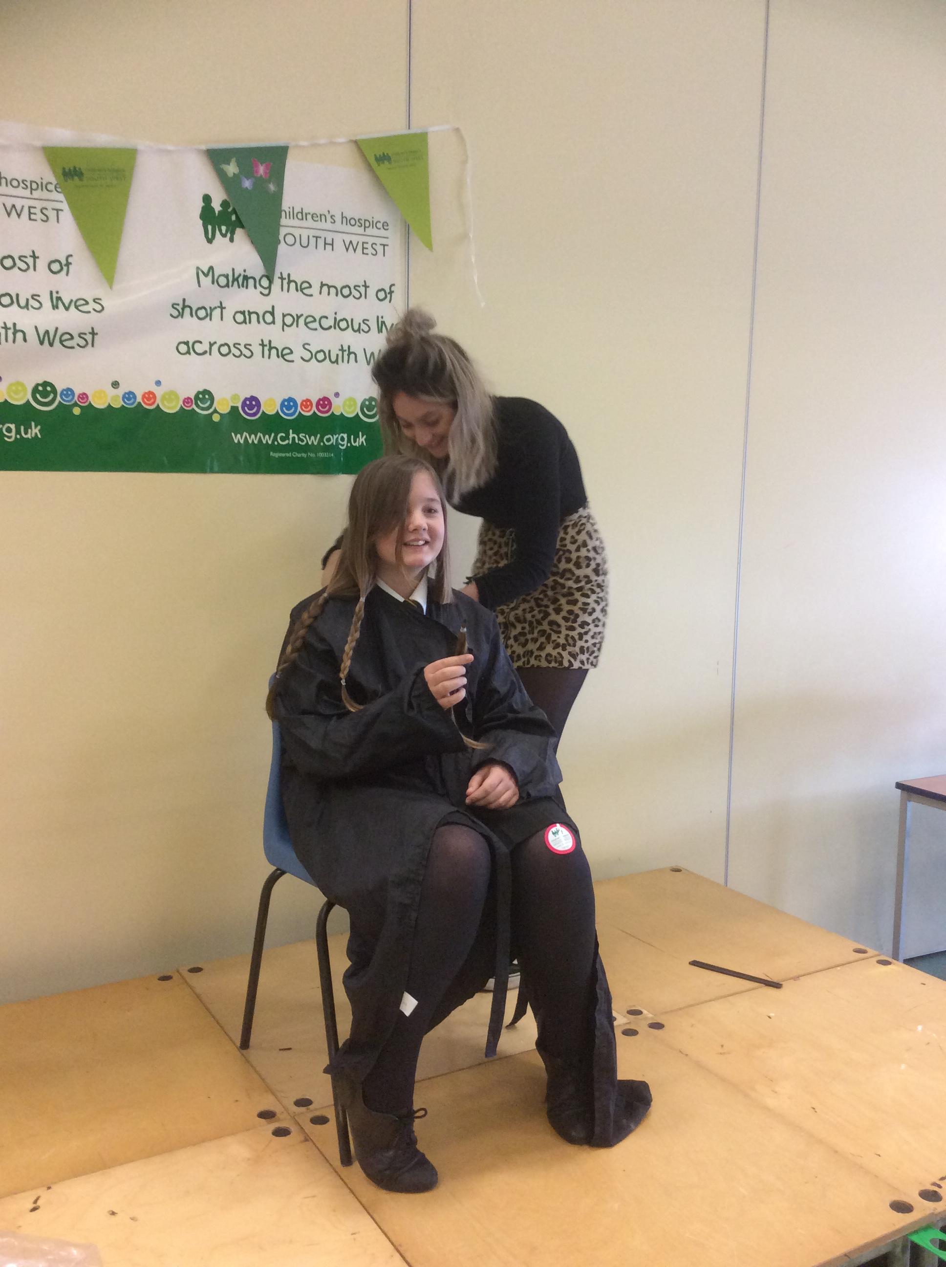 Anna getting her hair cut.