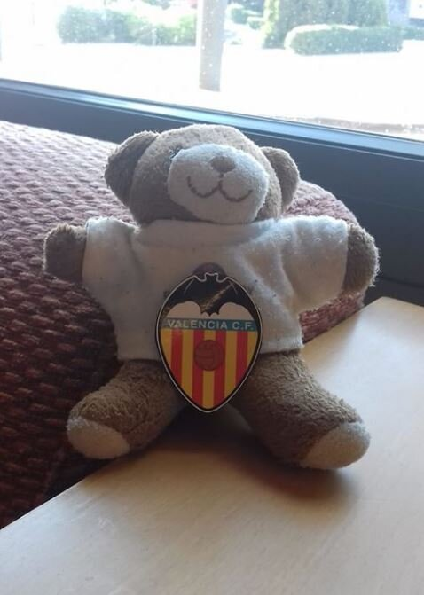 Wearing the Valencia Football team's colours with pride