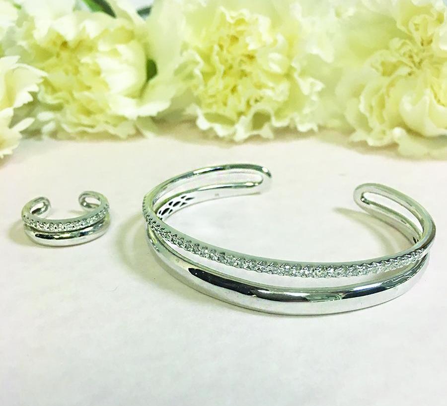 "Adelle's ""biggest splurge"", her diamond bangle and matching dress ring."
