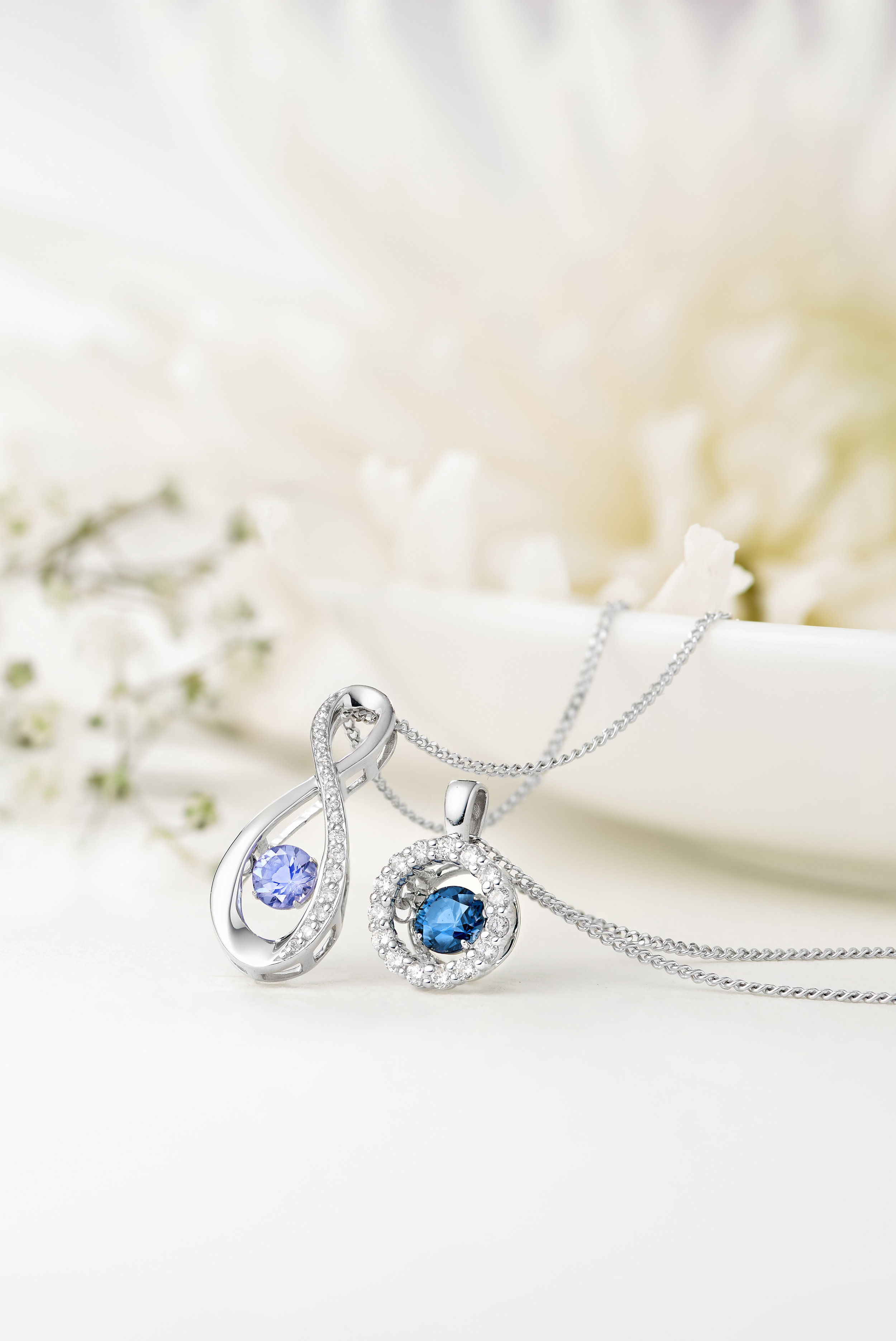 Add a splash of sophisticated colour with our  Dance by Beaverbrooks 9ct White Gold Blue Topaz Diamond Pendant  and the  9ct White Gold Sapphire and Diamond Pendant .