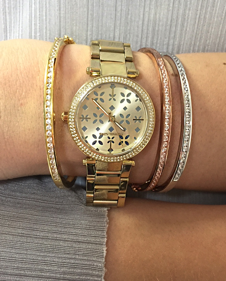 Layer up with our  silver ,  gold plated  and  rose gold plated  bangle and this exclusive-to-us  Michael Kors Mini Parker Watch .
