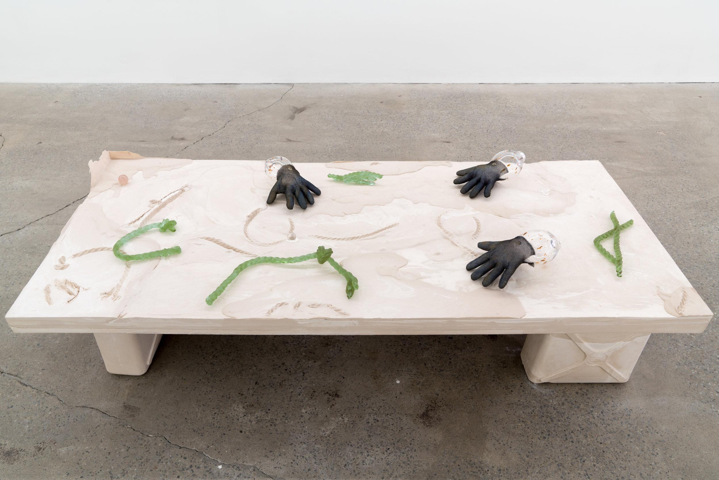"""Lorna Bauer,  The Hand of Mee and the Moonflower no.2, 2018,  verre soufflé, gants de boucher en acier, cristaux de verre dichroïque moulés, sphère de cristal, plâtre, bois, 51 x 91 x 213 cm (20"""" x 36"""" x 84"""")"""