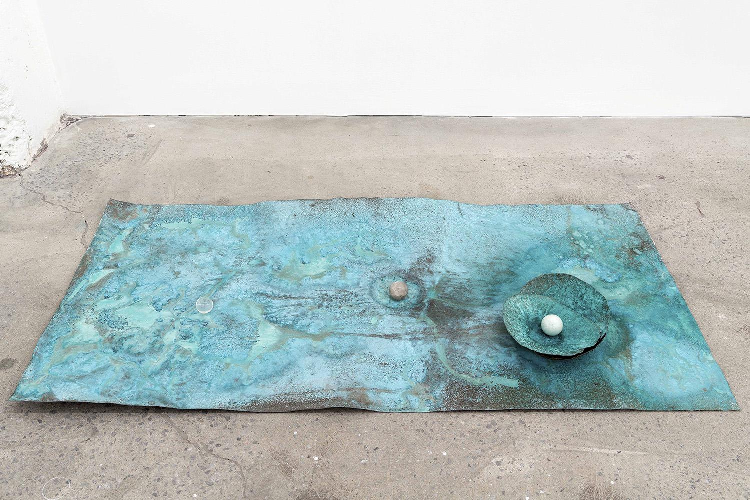 """Lorna Bauer,  The Toilers , 2018, cuivre , patine Miracle Grow, sphère de cristal,  61 x 122 cm (24"""" x 48"""")"""